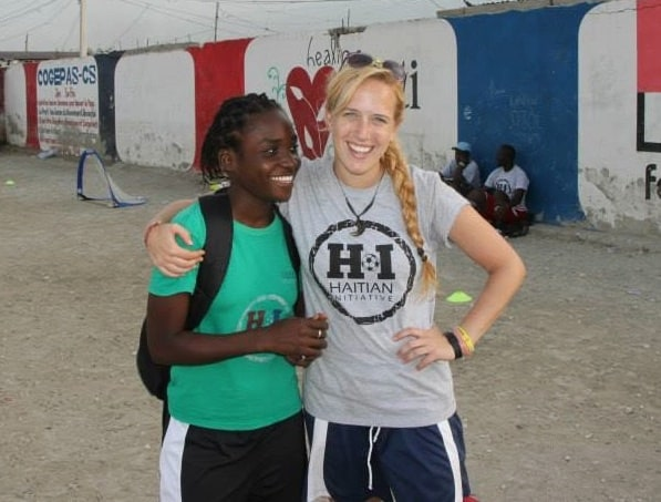 Coaches Across Continents Communications Strategist Nora Dooley makes a friend in Haiti