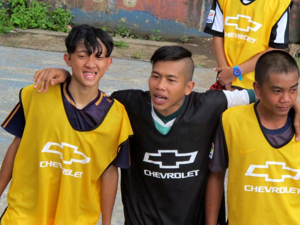 Ginan (center) is the star of the new Chevrolet FC video highlighting the partnership with Coaches Across Continents