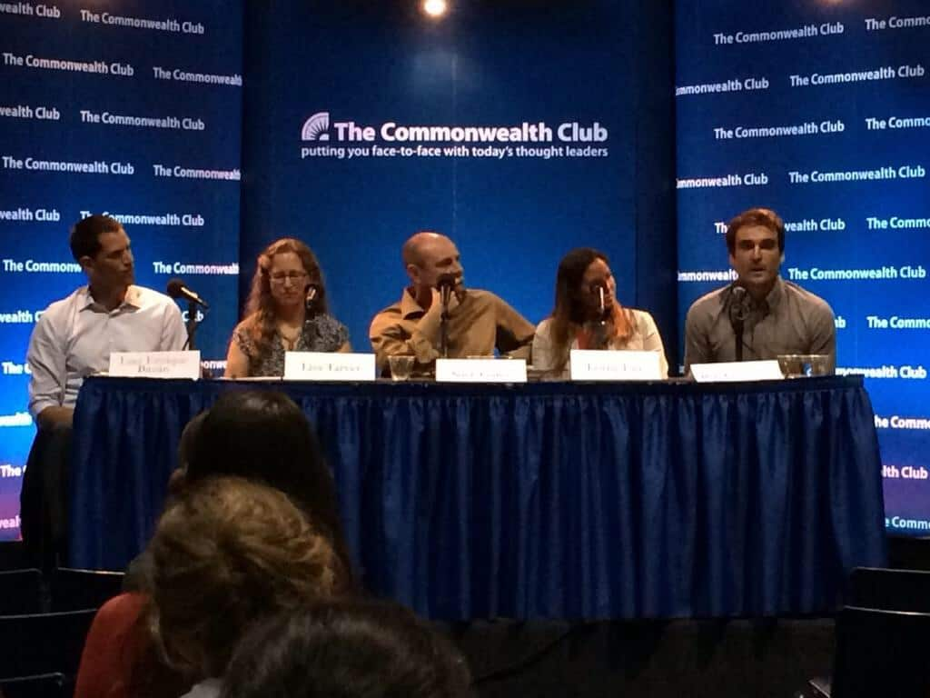 Coaches Across Continents founder Nick Gates (center) speaks at the Commonwealth Club